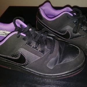 Black and purple nike shoes